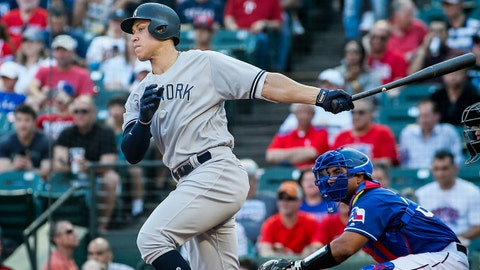 May 23, 2018; Arlington, TX, USA; New York Yankees right fielder Aaron Judge (99) singles in the second ininng against the Texas Rangers at Globe Life Park in Arlington. Mandatory Credit: Ray Carlin-USA TODAY Sports