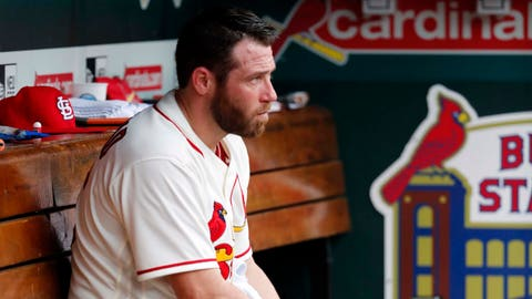 St. Louis Cardinals relief pitcher Greg Holland sits in the dugout during the eighth inning of a baseball game against the Philadelphia Phillies, Saturday, May 19, 2018, in St. Louis. The Phillies won 7-6. (AP Photo/Jeff Roberson)