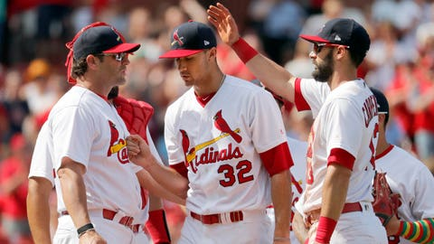 St. Louis Cardinals starting pitcher Jack Flaherty (32) is congratulated by teammate Matt Carpenter, right, as he is removed by manager Mike Matheny, left, during the eighth inning of a baseball game against the Philadelphia Phillies, Sunday, May 20, 2018, in St. Louis. (AP Photo/Jeff Roberson)
