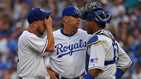 May 19, 2018; Kansas City, MO, USA; Kansas City Royals starting pitcher Danny Duffy (left) talks with pitching coach Cal Eldred (center) and catcher Salvador Perez (right) during the fourth inning against the New York Yankees at Kauffman Stadium. Mandatory Credit: Peter G. Aiken/USA TODAY Sports