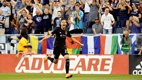 May 5, 2018; Kansas City, KS, USA; Sporting Kansas City forward Daniel Salloi (20) celebrates after scoring a goal during the first half of the match against the Colorado Rapids at Children's Mercy Park. Mandatory Credit: Denny Medley-USA TODAY Sports
