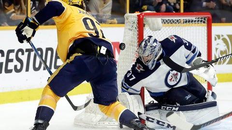 Winnipeg Jets goalie Connor Hellebuyck (37) blocks a shot by Nashville Predators center Ryan Johansen (92) during the second period in Game 5 of an NHL hockey second-round playoff series Saturday, May 5, 2018, in Nashville, Tenn. (AP Photo/Mark Humphrey)