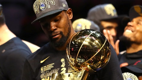 CLEVELAND, OH - JUNE 08: Kevin Durant #35 of the Golden State Warriors celebrates with the Larry O'Brien Trophy after defeating the Cleveland Cavaliers during Game Four of the 2018 NBA Finals at Quicken Loans Arena on June 8, 2018 in Cleveland, Ohio. The Warriors defeated the Cavaliers 108-85 to win the 2018 NBA Finals. NOTE TO USER: User expressly acknowledges and agrees that, by downloading and or using this photograph, User is consenting to the terms and conditions of the Getty Images License Agreement.  (Photo by Gregory Shamus/Getty Images)