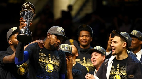 CLEVELAND, OH - JUNE 08:  Kevin Durant #35 of the Golden State Warriors raises the Bill Russell NBA Finals MVP trophy after winning the 2018 NBA Finals 108-85 against the Cleveland Cavaliers in Game Four at Quicken Loans Arena on June 8, 2018 in Cleveland, Ohio. NOTE TO USER: User expressly acknowledges and agrees that, by downloading and or using this photograph, User is consenting to the terms and conditions of the Getty Images License Agreement.  (Photo by Gregory Shamus/Getty Images)