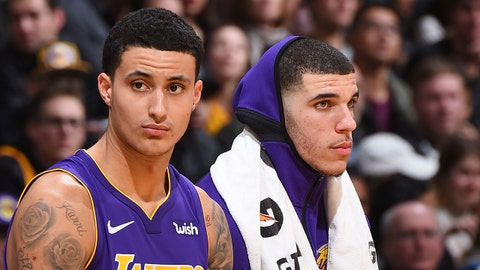 LOS ANGELES, CA - DECEMBER 23:  Kyle Kuzma #0 of the Los Angeles Lakers and Lonzo Ball #2 of the Los Angeles Lakers look on during the game against the Portland Trail Blazers on December 23, 2017 at STAPLES Center in Los Angeles, California. NOTE TO USER: User expressly acknowledges and agrees that, by downloading and/or using this Photograph, user is consenting to the terms and conditions of the Getty Images License Agreement. Mandatory Copyright Notice: Copyright 2017 NBAE (Photo by Andrew D. Bernstein/NBAE via Getty Images)