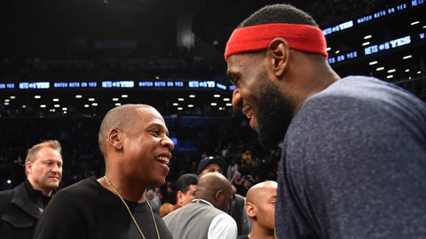 NEW YORK - DECEMBER 8: Hip Hop Artist Jay-Z greets LeBron James #23 of the Cleveland Cavaliers after the game against the Brooklyn Nets at the Barclays Center on December 8, 2014 in the Brooklyn borough of New York City. NOTE TO USER: User expressly acknowledges and agrees that, by downloading and/or using this photograph, user is consenting to the terms and conditions of the Getty Images License Agreement.  Mandatory Copyright Notice: Copyright 2014 NBAE (Photo by Jesse D. Garrabrant/NBAE via Getty Images)