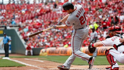 Washington Nationals' Daniel Murphy hits a two-run home run off Cincinnati Reds starting pitcher Homer Bailey in the first inning of a baseball game, Sunday, July 16, 2017, in Cincinnati. (AP Photo/John Minchillo)