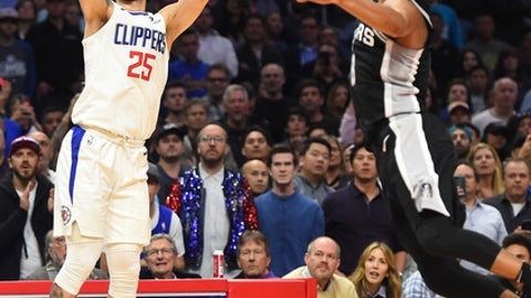 LOS ANGELES, CA - APRIL 03:   Austin Rivers #25 of the Los Angeles Clippers shoots and scores a three-point basket with .47 left on the clock in the fourth quarter of the game against Patty Mills #8 of the San Antonio Spurs at Staples Center on April 3, 2018 in Los Angeles, California. (Photo by Jayne Kamin-Oncea/Getty Images)
