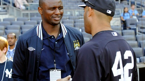 FILE - In this Friday, May 17, 2013 file photo, New York Yankees pitcher Mariano Rivera, right, chats with Patrick Vieira during batting practice, at Yankee Stadium in New York. Arsenal is looking for a new manager for the first time this century after Arsene Wenger on Friday, April 20, 2018 announced his decision to leave his role at the end of this season. The favorite with British bookmakers, the 41-year-old Vieira was one of Wenger's first signings and went on to become one of Arsenals greatest ever players in a nine-year spell. (AP Photo/Bill Kostroun, file)