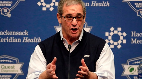 FILE - In this April 19, 2018, file photo, New York Giants Dave Gettleman speaks to reporters during a press conference in East Rutherford, N.J. If the new general manager is convinced there is a guy who can lead to the team to a couple of Super Bowls _ and the Cleveland Browns havent taken him _ the Giants grab a quarterback.  Its that simple when you are coming off a 3-13 season and Eli Manning is 37 years old. (AP Photo/Julio Cortez, File)