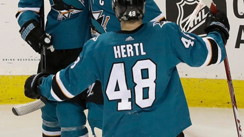 San Jose Sharks center Joe Pavelski, center, celebrates with Logan Couture (39) and Tomas Hertl after scoring a goal against the Vegas Golden Knights during the third period of Game 4 of an NHL hockey second-round playoff series in San Jose, Calif., Wednesday, May 2, 2018. The Sharks won 4-0. (AP Photo/Jeff Chiu)