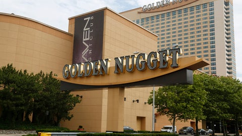 FILE - In this June 19, 2017, file photo, the Golden Nugget Hotel and Casino stands in Atlantic City, N.J. The Supreme Court ruling earlier this week allows states to offer sports betting. Churchill Downs Inc. wasted little time taking a step on this new frontier. The company announced an agreement Wednesday, May 16, with Golden Nugget Atlantic City to enter online gambling and sports betting in New Jersey. (AP Photo/Seth Wenig, File)