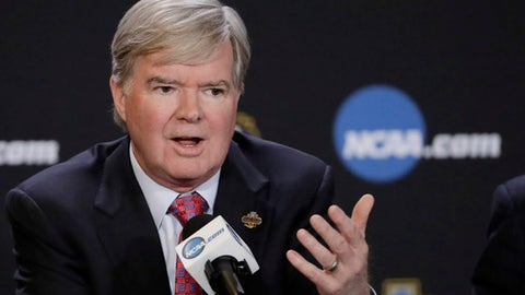 """FILE - In this March 30, 2017, file photo, NCAA President Mark Emmert answers a question during a news conference in Glendale, Ariz. The NCAA is opening a door for states with legalized sports gambling to host NCAA championship events. The governing body for college sports on Thursday, May 17, 2018, announced a """"temporary"""" lifting of a ban that prevented events like college basketball's NCAA Tournament from being hosted in states that accept wagers on single games.  (AP Photo/David J. Phillip, File)"""