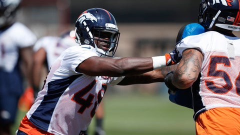 Denver Broncos linebacker Shaquil Barrett, left, takes part in a drill with linebacker Shane Ray during practice at the NFL football team's training camp Tuesday, May 29, 2018, in Englewood, Colo. (AP Photo/David Zalubowski)