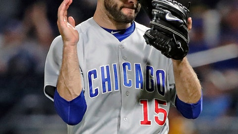 Chicago Cubs relief pitcher Brandon Morrow celebrates after the final out in the team's 8-6 win over the Pittsburgh Pirates in a baseball game in Pittsburgh, Tuesday, May 29, 2018. (AP Photo/Gene J. Puskar)