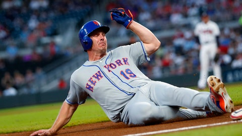 New York Mets' Jay Bruce (19) slides into third base on a fly ball by Kevin Plawecki during the fourth inning of a baseball game against the Atlanta Braves on Wednesday, May 30, 2018, in Atlanta. New York won 4-1. (AP Photo/John Bazemore)