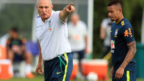 Brazil coach Tite, left, is flanked by Jesus as he leads a training session ahead of Sunday's friendly soccer match against Croatia, at the Enfield Training center, in London Thursday, May 31, 2018. (Adam Davy/PA via AP)
