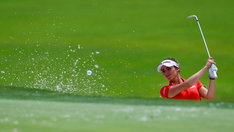 Gaby Lopez, of Mexico, hits out of the bunker to the 18th green during the first round of the U.S. Women's Open golf tournament, Thursday, May 31, 2018, in Shoal Creek, Ala. (AP Photo/Butch Dill)