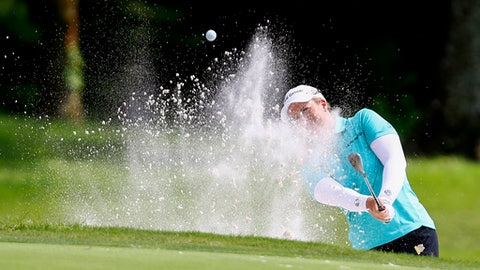 Brittany Lincicome hits out of the bunker to the sixth green during the first round of the U.S. Women's Open golf tournament, Thursday, May 31, 2018, in Shoal Creek, Ala. (AP Photo/Butch Dill)