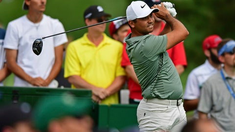 Jason Day, from Australia, watches his shot form the 15th tee during the first round of the Memorial golf tournament Thursday, May 31, 2018, in Dublin, Ohio. (AP Photo/David Dermer)