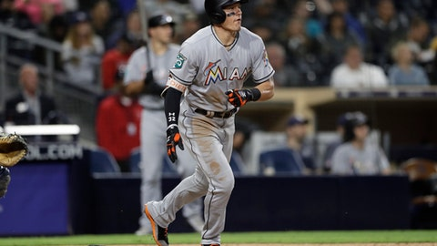Miami Marlins' Derek Dietrich watches his home run against the San Diego Padres during the eighth inning of a baseball game Thursday, May 31, 2018, in San Diego. (AP Photo/Gregory Bull)