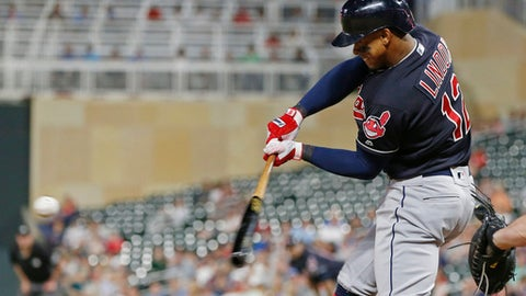 Cleveland Indians' Francisco Lindor hits a solo home run off Minnesota Twins pitcher Addison Reed during the eighth inning of a baseball game Thursday, May 31, 2018, in Minneapolis. Lindor went 4-for-5, including a three-run home run in the fourth inning. (AP Photo/Jim Mone)