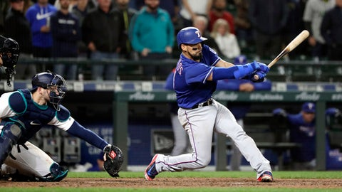 Texas Rangers' Robinson Chirinos swings and misses to end the baseball game as Seattle Mariners catcher Mike Zunino catches the ball Thursday, May 31, 2018, in Seattle. The Mariners won 6-1. (AP Photo/Elaine Thompson)