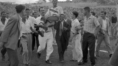 FILE - In this June 28, 1950 file photo, U.S. center forward Joe Gaetjens is carried off by cheering fans after his team beat England 1-0 in a World Cup soccer match in Belo Horizonte, Brazil. Gaetjens scored the only goal in what remains one of the biggest shocks in the tournament's history. The 21st World Cup begins on Thursday, June 14, 2018, when host Russia takes on Saudi Arabia. (AP Photo/File)