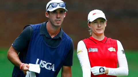 Sarah Jane Smith, of Australia, and her caddie husband, Duane Smith, talks about her tee shot on the 18th hole during the second round of the U.S. Women's Open golf tournament at Shoal Creek, Friday, June 1, 2018, in Birmingham, Ala. (AP Photo/Butch Dill)