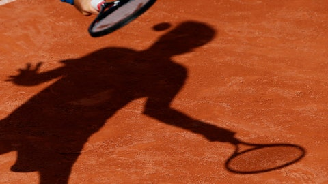 Jared Donaldson, of the U.S, slams a forehand to Bulgaria's Grigor Dimitrov during their second round match of the French Open tennis tournament at the Roland Garros stadium, Wednesday, May 30, 2018 in Paris. (AP Photo/Thibault Camus)