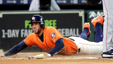 Houston Astros' George Springer scores on a wild pitch by Boston Red Sox starting pitcher Chris Sale during the first inning of a baseball game Friday, June 1, 2018, in Houston. (AP Photo/David J. Phillip)