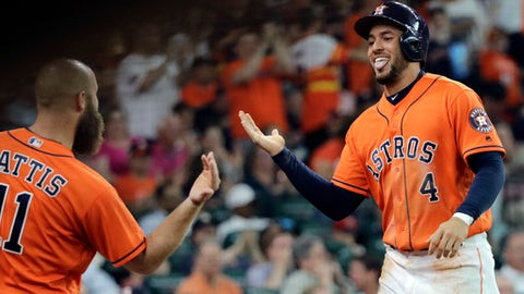Houston Astros' George Springer (4) celebrates with Evan Gattis (11) after scoring against the Boston Red Sox during the first inning of a baseball game Friday, June 1, 2018, in Houston. (AP Photo/David J. Phillip)