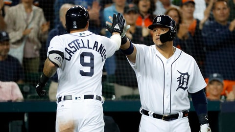 Detroit Tigers' Nicholas Castellanos (9) celebrates his solo home run with Miguel Cabrera in the seventh inning of a baseball game against the Toronto Blue Jays in Detroit, Friday, June 1, 2018. (AP Photo/Paul Sancya)