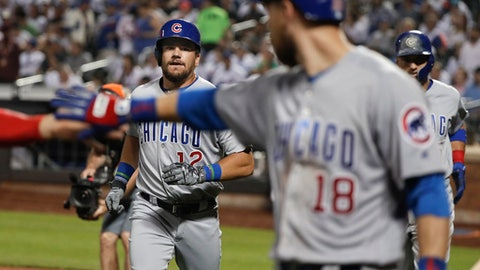 Chicago Cubs' Kyle Schwarber (12) looks to celebrate with teammates after hitting a three-run home run against the New York Mets during the eighth inning of a baseball game, Friday, June 1, 2018, in New York. (AP Photo/Julie Jacobson)