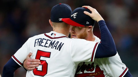 Atlanta Braves starting pitcher Mike Foltynewicz, right, hugs first baseman Freddie Freeman (5) after the team's 4-0 win in a baseball game against the Washington Nationals on Friday, June 1, 2018, in Atlanta. Foltynewicz pitched a two-hitter. (AP Photo/John Bazemore)