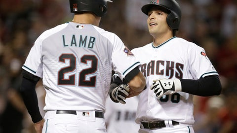 Arizona Diamondbacks' John Ryan Murphy celebrates with Jake Lamb (22) after hitting a two-run home run against the Miami Marlins during the fifth inning during a baseball game Friday, June 1, 2018, in Phoenix. (AP Photo/Rick Scuteri)