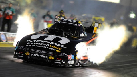 In this photo provided by the NHRA, Matt Hagan drives in Funny Car qualifying Friday, June 1, 2018, at the Route 66 NHRA Nationals drag races at Route 66 Raceway in Joliet, Ill. (Teresea Long/NHRA via AP)