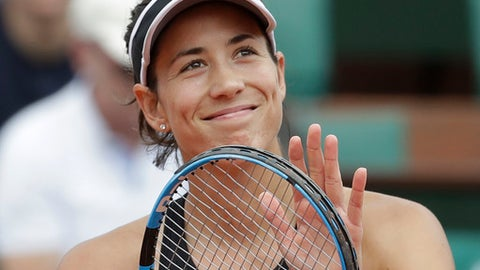 Spain's Garbine Muguruza celebrates winning her third round match of the French Open tennis tournament against Australia's Samantha Stosur in two sets 6-0, 6-2, at the Roland Garros stadium in Paris, France, Saturday, June 2, 2018. (AP Photo/Alessandra Tarantino)