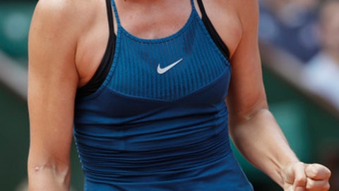 Russia's Maria Sharapova clenches her fist after scoring a point against Karolina Pliskova of the Czech Republic during their third round match of the French Open tennis tournament at the Roland Garros stadium in Paris, France, Saturday, June 2, 2018. (AP Photo/Alessandra Tarantino)