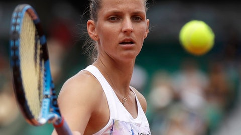 Karolina Pliskova of the Czech Republic returns a shot against Russia's Maria Sharapova during their third round match of the French Open tennis tournament at the Roland Garros stadium in Paris, France, Saturday, June 2, 2018. (AP Photo/Alessandra Tarantino)