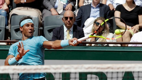 Spain's Rafael Nadal returns the ball to France's Richard Gasquet during their third round match of the French Open tennis tournament at the Roland Garros stadium, Saturday, June 2, 2018 in Paris. (AP Photo/Alessandra Tarantino)