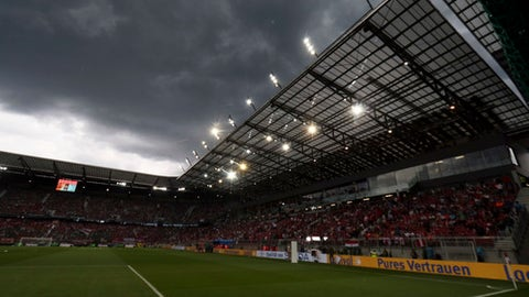 Dark clouds move over the stadium as heavy rain and hail delay the start of a friendly soccer match between Austria and Germany in Klagenfurt, Austria, Saturday, June 2, 2018. (AP Photo/Ronald Zak)