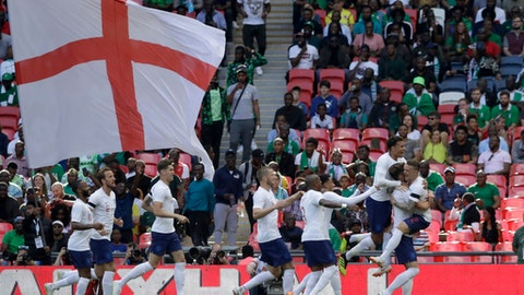 England's Gary Cahill, second from right, celebrates with his teammates after scoring the opening goal during a friendly soccer match between England and Nigeria at Wembley stadium in London, Saturday, June 2, 2018. (AP Photo/Matt Dunham)