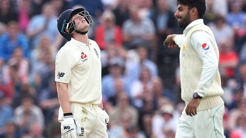 England's Dominic Bess reacts after getting out on 49 from the bowling of Pakistan's Shadab Khan, right, during Day 2 of the second and final test between England and Pakistan at Headingley, Leeds, Britain, Saturday, June 2, 2018. (Martin Rickett/PA via AP)