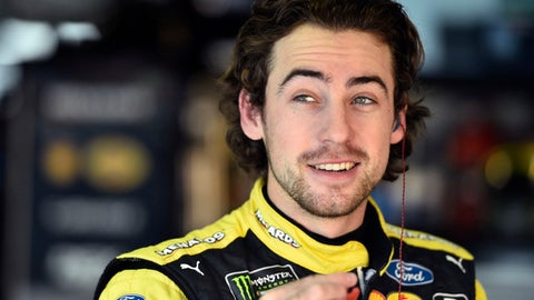 Ryan Blaney smiles in the garage prior to a practice session for Sunday's NASCAR Cup Series auto race, Saturday, June 2, 2018, in Long Pond, Pa. (AP Photo/Derik Hamilton)
