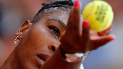 Serena Williams of the U.S. serves against Germany's Julia Georges during their third round match of the French Open tennis tournament at the Roland Garros stadium in Paris, France, Saturday, June 2, 2018. (AP Photo/Christophe Ena )