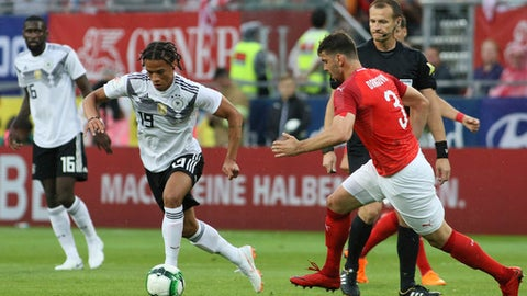 Germany's Leroy Sane runs with the ball followed by Austria's Aleksandar Dragovic, right, during a friendly soccer match between Austria and Germany in Klagenfurt, Austria, Saturday, June 2, 2018. (AP Photo/Ronald Zak)