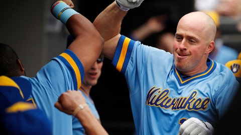 Milwaukee Brewers' Erik Kratz, right, celebrates his home run against the Chicago White Sox with teammates during the third inning of a baseball game Saturday, June 2, 2018, in Chicago. (AP Photo/Jim Young)
