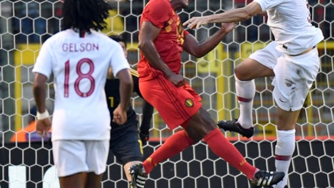 Belgium's Vincent Kompany, center left, goes up against Portugal's Pepe during a friendly soccer match between Belgium and Portugal at the King Baudouin stadium in Brussels, Saturday, June 2, 2018. (AP Photo/Geert Vanden Wijngaert)
