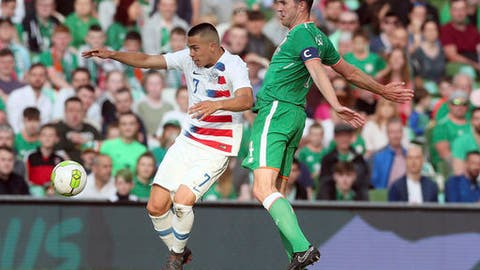 United States' Bobby Wood, left, and Republic of Ireland's John O'Shea battle for the ball during the International Friendly match at the Aviva Stadium, Dublin, Ireland, Saturday June 2, 2018. (Brian Lawless/PA via AP)